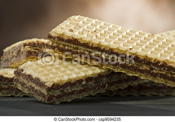 chocolate wafer in different position on the table - csp9594235