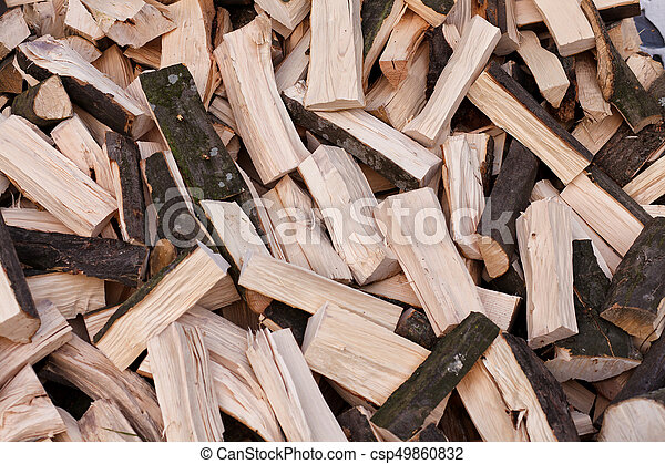chopped firewood on a stack - csp49860832
