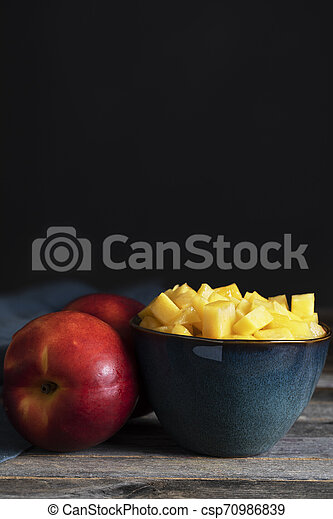 Chopped Nectarine in Bowls - csp70986839