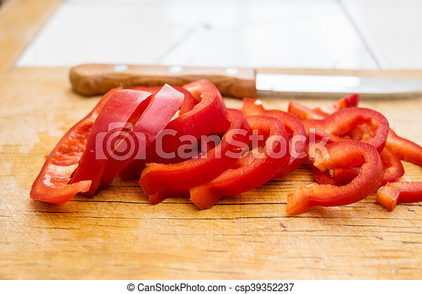 Chopped red bell pepper on a cutting board - csp39352237