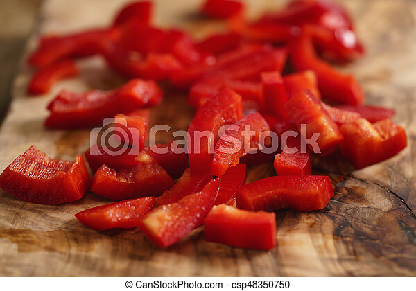chopped red bell pepper on cutting board - csp48350750