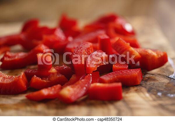 chopped red bell pepper on cutting board - csp48350724