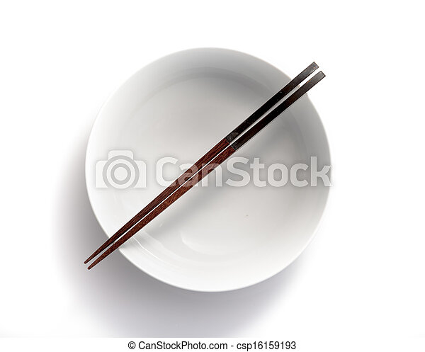 chopsticks in empty bowl isolated on a white background - csp16159193