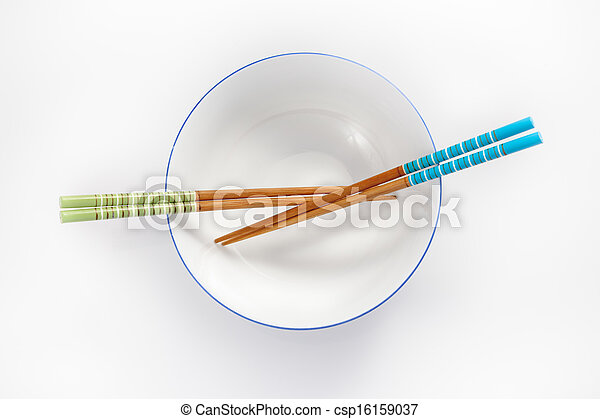 chopsticks in empty bowl isolated on a white background - csp16159037