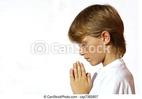 christian child praying  hands clasped in prayer - csp7382807