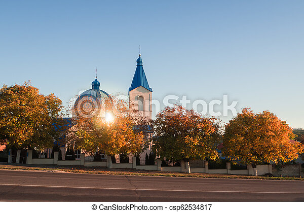 Christian Church on the road in autumn at sunset. - csp62534817