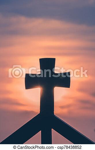 christian cross at the sunset - csp78438852