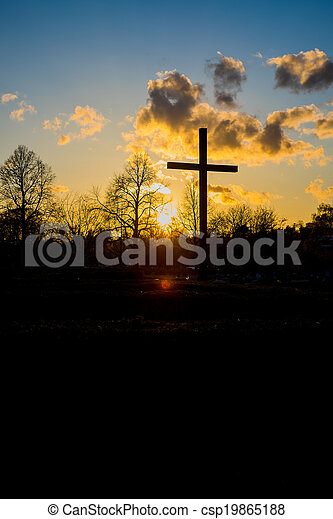 Christian cross in the sunset - csp19865188