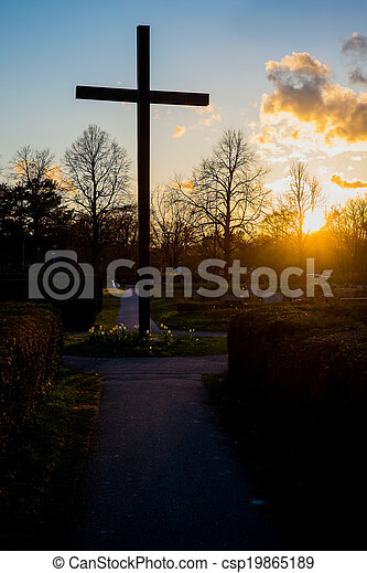 Christian cross in the sunset - csp19865189
