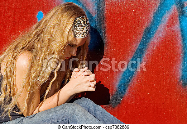 christian girl or teen saying prayers, hands clasped praying - csp7382886