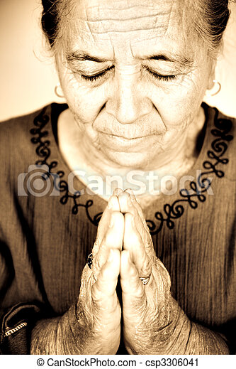Christian senior woman praying to God - csp3306041