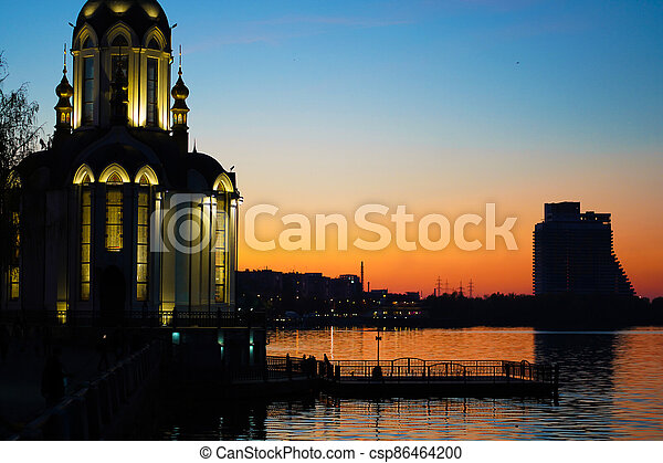 Christian temple by the water at sunset - csp86464200