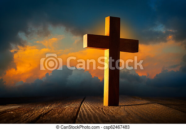 Christian wood cross on sunset sky - csp62467483