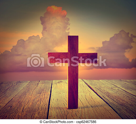 Christian wood cross on sunset sky - csp62467586