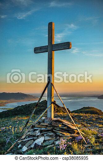 Christian wooden cross on hill - csp38085935