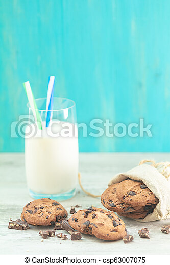 Christmas and New Year composition with delicious chocolate cookies and glass of milk - csp63007075