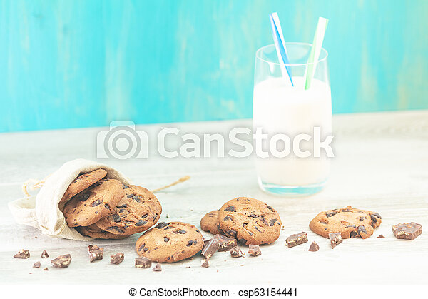 Christmas and New Year composition with delicious chocolate cookies and glass of milk - csp63154441