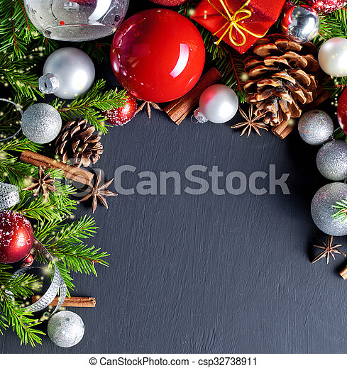 Christmas and new year decoration on black wooden background - csp32738911