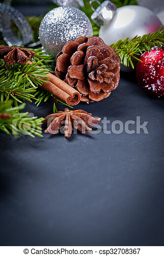 Christmas and new year decoration on black wooden background - csp32708367