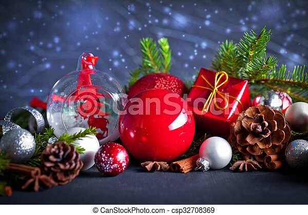 Christmas and new year decoration on black wooden background - csp32708369