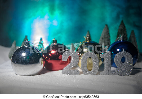 Christmas background with baubles, on snow, free space for text. Christmas decoration. - csp63543563