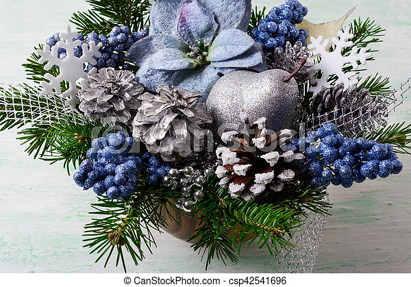 Christmas Flower Arrangements Artificial.Christmas Background With Blue Silk Poinsettias And Glitter Berries