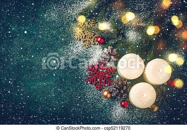 Christmas background with candles and snow. xmas greeting card.