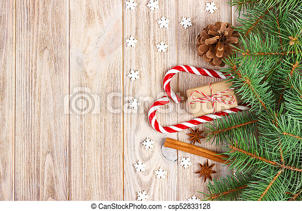 Christmas Background With Christmas Tree Branches Pine Cones Candy