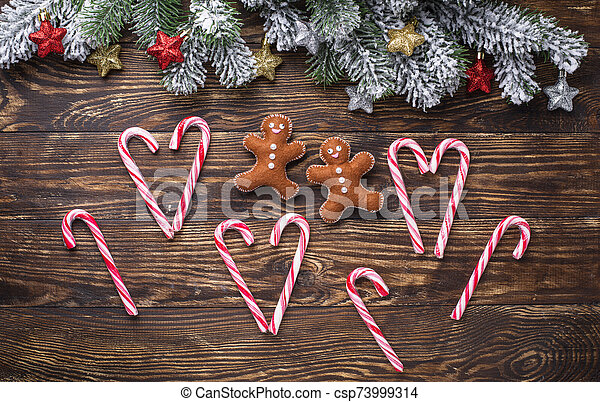 Christmas background with felt gingerbread man - csp73999314