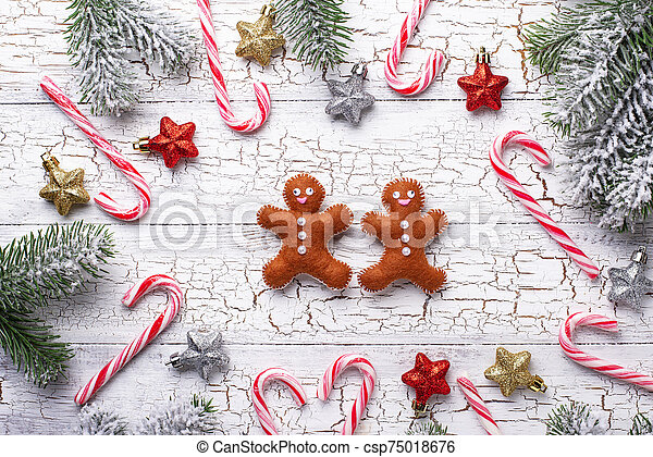 Christmas background with felt gingerbread man - csp75018676