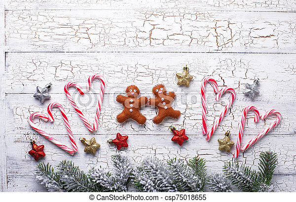 Christmas background with felt gingerbread man - csp75018655