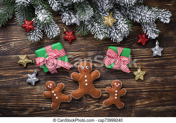 Christmas background with felt gingerbread man - csp73999240