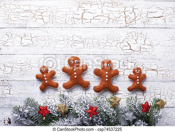 Christmas background with felt gingerbread man - csp74537225
