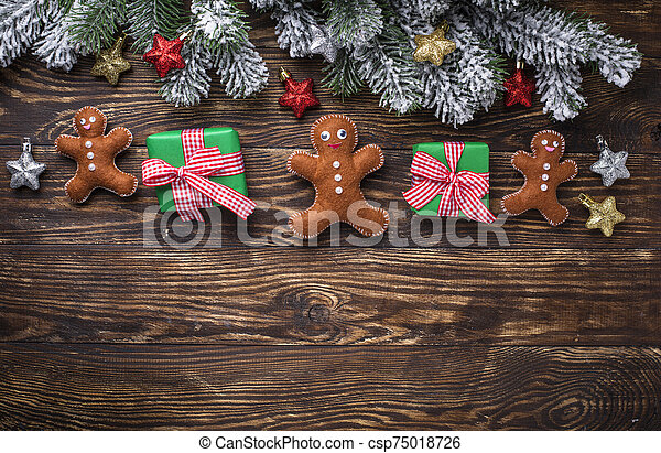Christmas background with felt gingerbread man - csp75018726