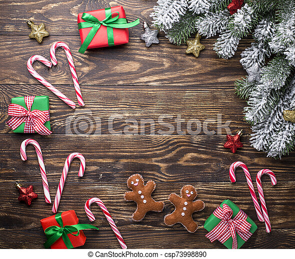 Christmas background with felt gingerbread man - csp73998890