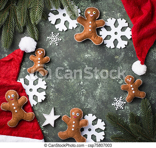 Christmas background with felt gingerbread man - csp75807003