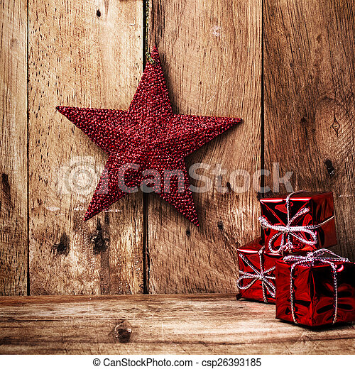 Christmas Background With Festive Decorations On Old Wooden Wall Old Fashioned Christmas Red Star And Gift Boxes With Canstock