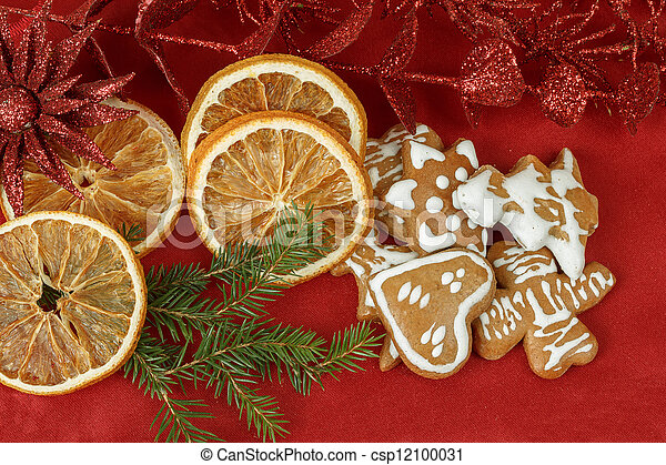 christmas background with needles. orange slices and gingerbreads - csp12100031