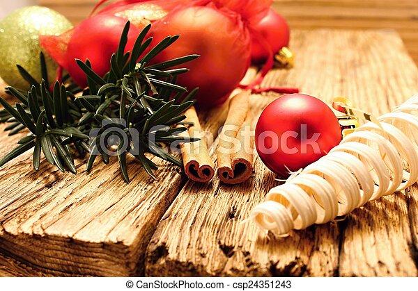 Christmas ball and cinnamon - csp24351243
