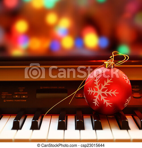 Christmas ball on piano keys - csp23015644