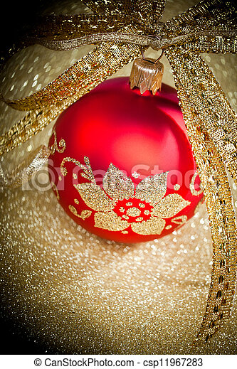 Christmas ball with golden ribbon - csp11967283