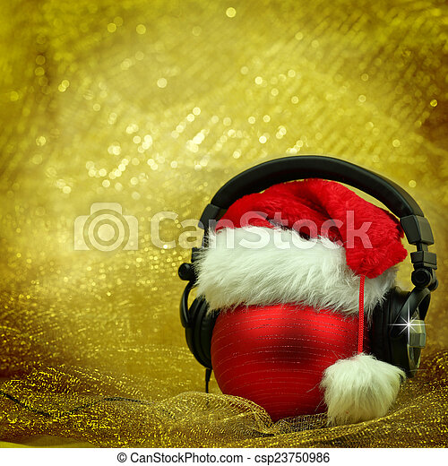 Christmas ball with headphones in glittering background - csp23750986