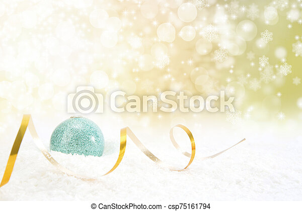 Christmas ball with ribbon on a glossy surface - csp75161794