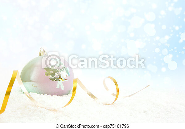 Christmas ball with ribbon on a glossy surface - csp75161796