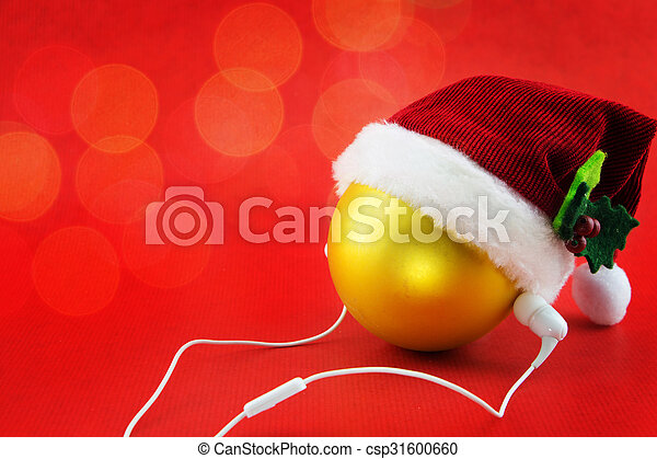 Christmas ball with Santa's hat and earphones, on red with bokeh lights - csp31600660