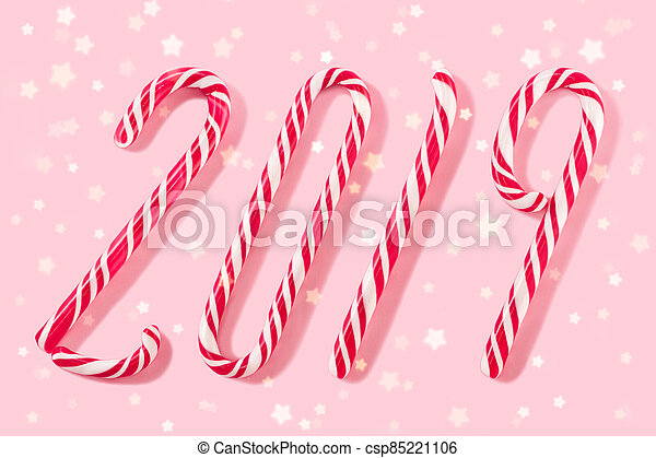 Christmas balls for decoration on a pink background. - csp85221106