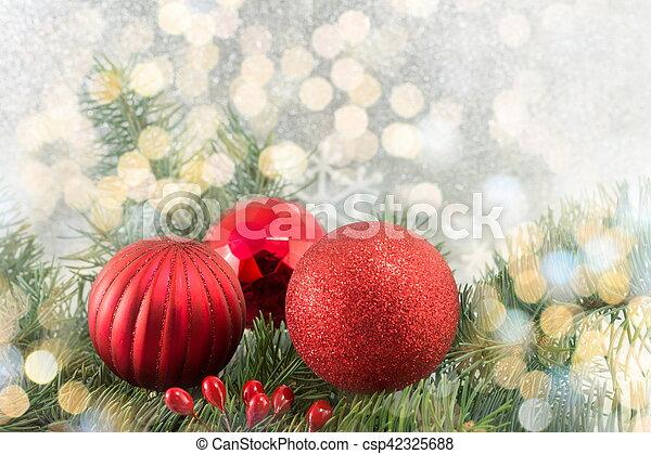 Christmas balls on shiny silver background - csp42325688