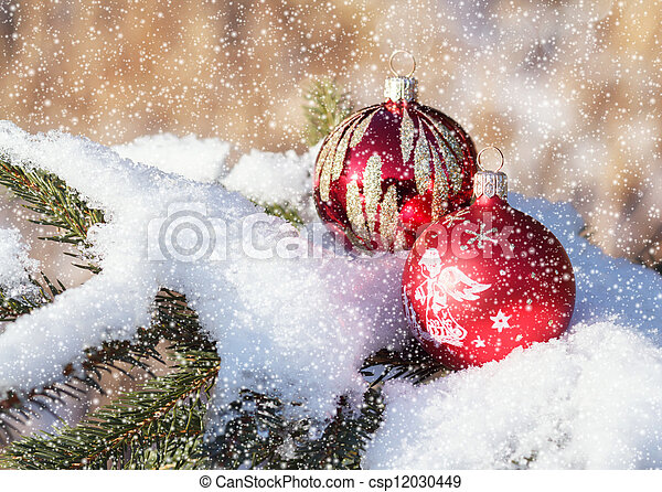 christmas balls on snowy day outdoor - csp12030449