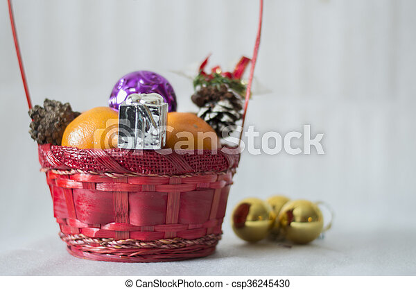 christmas basket with decorations csp36245430