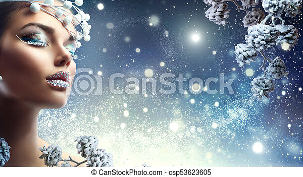 Christmas beauty girl. Winter holiday makeup with gems on lips - csp53623605